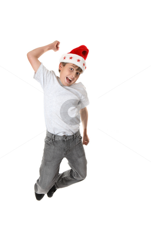 Christmas Jump for Joy stock photo, A child leaping into the air in celebration of Christmas by Leah-Anne Thompson