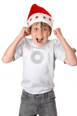 Christmas Glee stock photo, A child wearing a red santa hat jumps with glee and anticiapation. by Leah-Anne Thompson