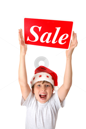 Excited boy with Sale Sign stock photo, An excited boy holding a sale sign over his head, suitable for pre or post Christmas sales. by Leah-Anne Thompson