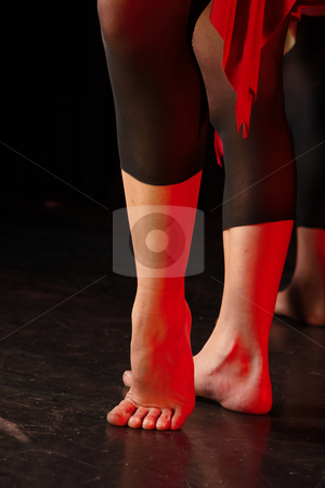 Dancers on stage stock photo, Bare feet of a dancer in point by Sean Nel