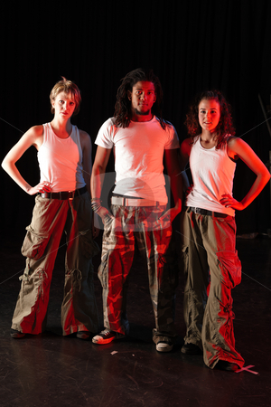 Dancers on stage stock photo, A group of two female and one male freestyle hip-hop dancers in a dancing training session. Lit with spotlights by Sean Nel