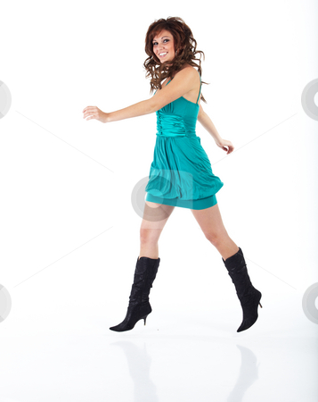 Young adult woman stock photo, Vibrant young adult caucasian woman in a short turquoise dress with black boots and a brunette wig, shot on a white background. Not isolated. by Sean Nel