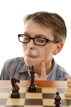 Chess player analyzing next move stock photo, A young chess player considering or thinking carefully about his next tactical move by Leah-Anne Thompson
