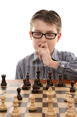 Game Plan stock photo, A young chess player contemplates a game plan or strategic move.  Skillful chess players look between 3 and 5 moves ahead. by Leah-Anne Thompson