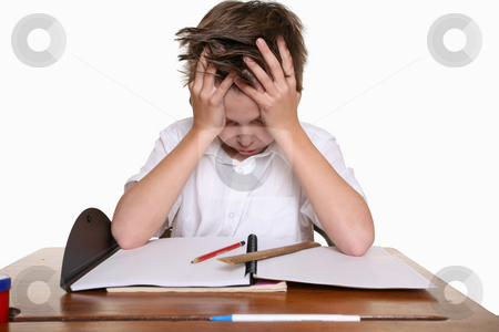 Child with learning difficulties stock photo, A frustrated, upset child, or child with learning difficulties. by Leah-Anne Thompson