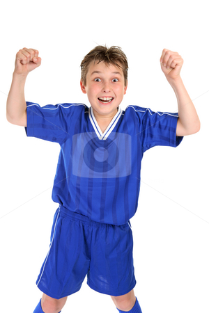 Soccer Glory stock photo, An elated boy celebrates with two fists in the air by Leah-Anne Thompson