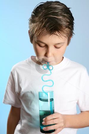 Child drinking through a straw stock photo, Closeup of a child drinking through a straw by Leah-Anne Thompson