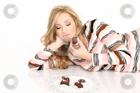 Chocolate Addict stock photo, A chocolate addict enjoying a selection of chcolate truffles. by Leah-Anne Thompson