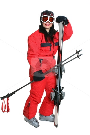 Female skier in red ski suit stock photo, Female skier wearing a red ski suit and carryng matching skis and poles. by Leah-Anne Thompson