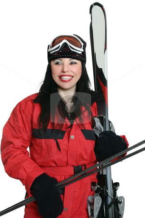 Ready for the slopes stock photo, A woman dressed in ski suit and carrying gear for skiing. by Leah-Anne Thompson