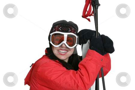 Female Skier stock photo, Female skier wearing warm red parka, beanie and goggles is leaning on skis and smiling. by Leah-Anne Thompson