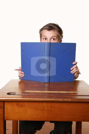 Bookworm reading book stock photo, A child sitting down reading a book by Leah-Anne Thompson