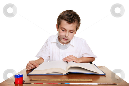 School student reading a book. stock photo, A school child reading a book or studying by Leah-Anne Thompson