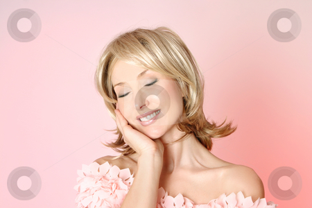 Femininity stock photo, Smiling woman resting head gently to one side by Leah-Anne Thompson