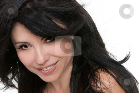 Woman windswept hair stock photo, Face of a pretty smiling woman with windswept brunette hair by Leah-Anne Thompson