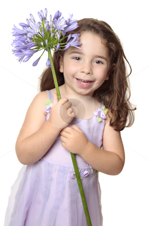 Little girl holding large african lily - agapanthus stock photo, Pretty girl dressed in a beautiful mauve dress is holding a large agapanthus flower and smiling with pure joy. by Leah-Anne Thompson