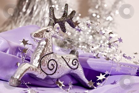 Silver deer stock photo, Holiday series: christmas decorated silver deer with garland by Gennady Kravetsky