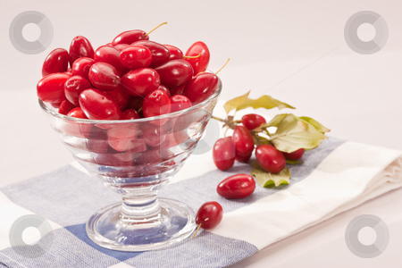Cornelian cherries stock photo, Food series: glasssy bowl with ripe Cornelian cherries by Gennady Kravetsky