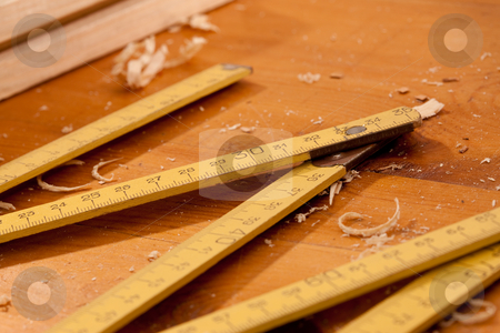 Ruler stock photo, Tools series: carpenter ruler on the wooden plank by Gennady Kravetsky