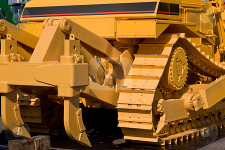 Track stock photo, Machinery series: yellow painted track of heavy bulldozer by Gennady Kravetsky
