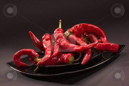Hot pepper stock photo, Food series: red hot pepper on black glassy plate by Gennady Kravetsky