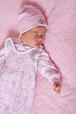 Newborn baby stock photo, Children series: slepping newborn baby in pink color by Gennady Kravetsky
