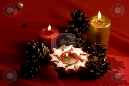 Christmas mood stock photo, Holiday series: Christmas candle on the red background by Gennady Kravetsky