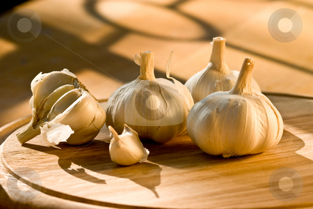 Garlic stock photo, Some garlic and chive garlic on the wooden board by Gennady Kravetsky