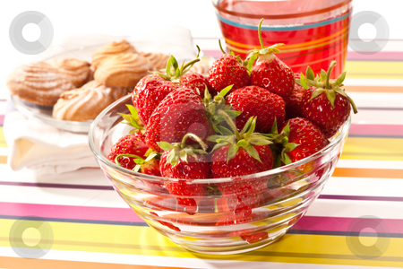 Strawberry stock photo, Food series: ripe red strawberries in bowl andpastry by Gennady Kravetsky