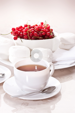 Cup of tea stock photo, Drink series: cup of tea with sweets and currants by Gennady Kravetsky