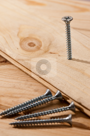 Nail stock photo, Tools series: long nails on wooden table by Gennady Kravetsky