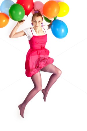 Girl holiday stock photo, People series:  young girl jumping with multicolored balloons by Gennady Kravetsky