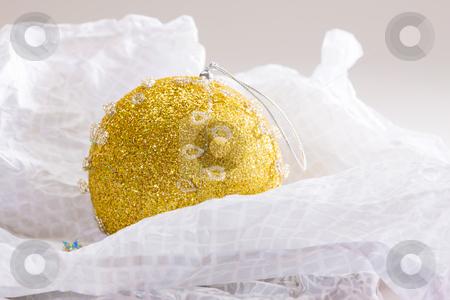 Golden Christmas ball stock photo, Holiday series: golden Christmas ball on the white paper by Gennady Kravetsky