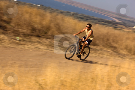 Cyclist stock photo, People series: high speed run cyclist on cycle by Gennady Kravetsky