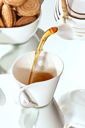 Morning tea stock photo, Drink series: cup of tea with pastry by Gennady Kravetsky