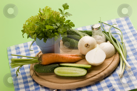 Vegeterian food stock photo, Fresh vegetables: onion, carrot, cucumber and parsley by Gennady Kravetsky
