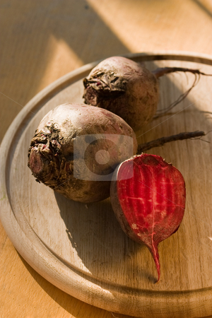 Red beet stock photo, Food series: red beet on the wooden board by Gennady Kravetsky