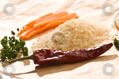 Raw rice stock photo, Hill of raw rice with vegetables 