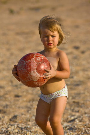 Little child with ball stock photo, People series: little girl play on the beach with ball by Gennady Kravetsky
