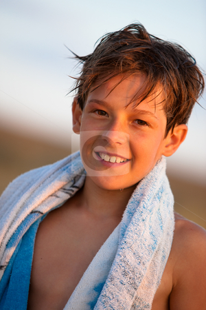Boy stock photo, People series: portrait of smiling boy with towel by Gennady Kravetsky
