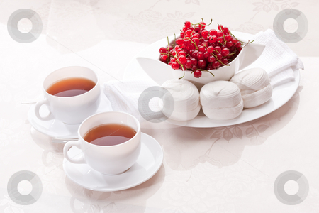 Marsh-mallow stock photo, Food series: white marsh-mallow with red currant with tea by Gennady Kravetsky