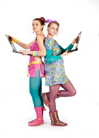 Modern computer girls stock photo, People series: young girls stand with computer by Gennady Kravetsky