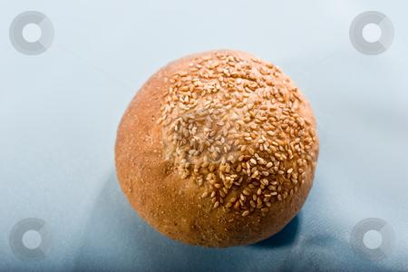 Bun stock photo, Food series: tasty round bun with seed by Gennady Kravetsky