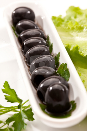 Olive stock photo, Food series: macro oicture of plate with black olive by Gennady Kravetsky