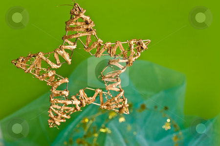 Christmas decoration stock photo, Holiday series: golden hand-made christmas star-shaped decoration by Gennady Kravetsky