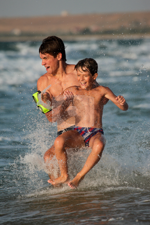 Play stock photo, People series: two boy are play the game on sea by Gennady Kravetsky