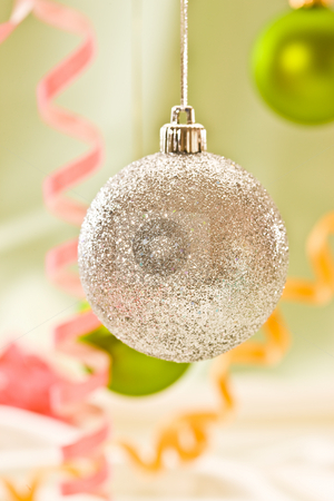 Christmas decoration stock photo, Holiday series:  Christmas decorated silver bal and streamer by Gennady Kravetsky