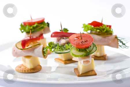 Light snack stock photo, Food theme: cracker with ham, cheese and vegetables on the plate by Gennady Kravetsky