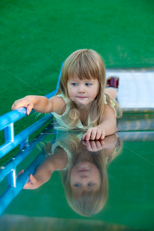 Play stock photo, People series: little girl play on the chute by Gennady Kravetsky
