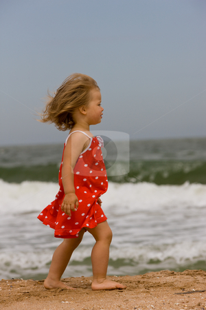 Little girl on the sea stock photo, People series: little girl are run on the beach by Gennady Kravetsky